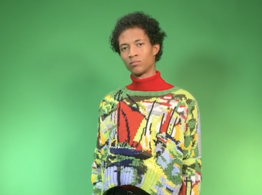 Male model stood infront of a green screen