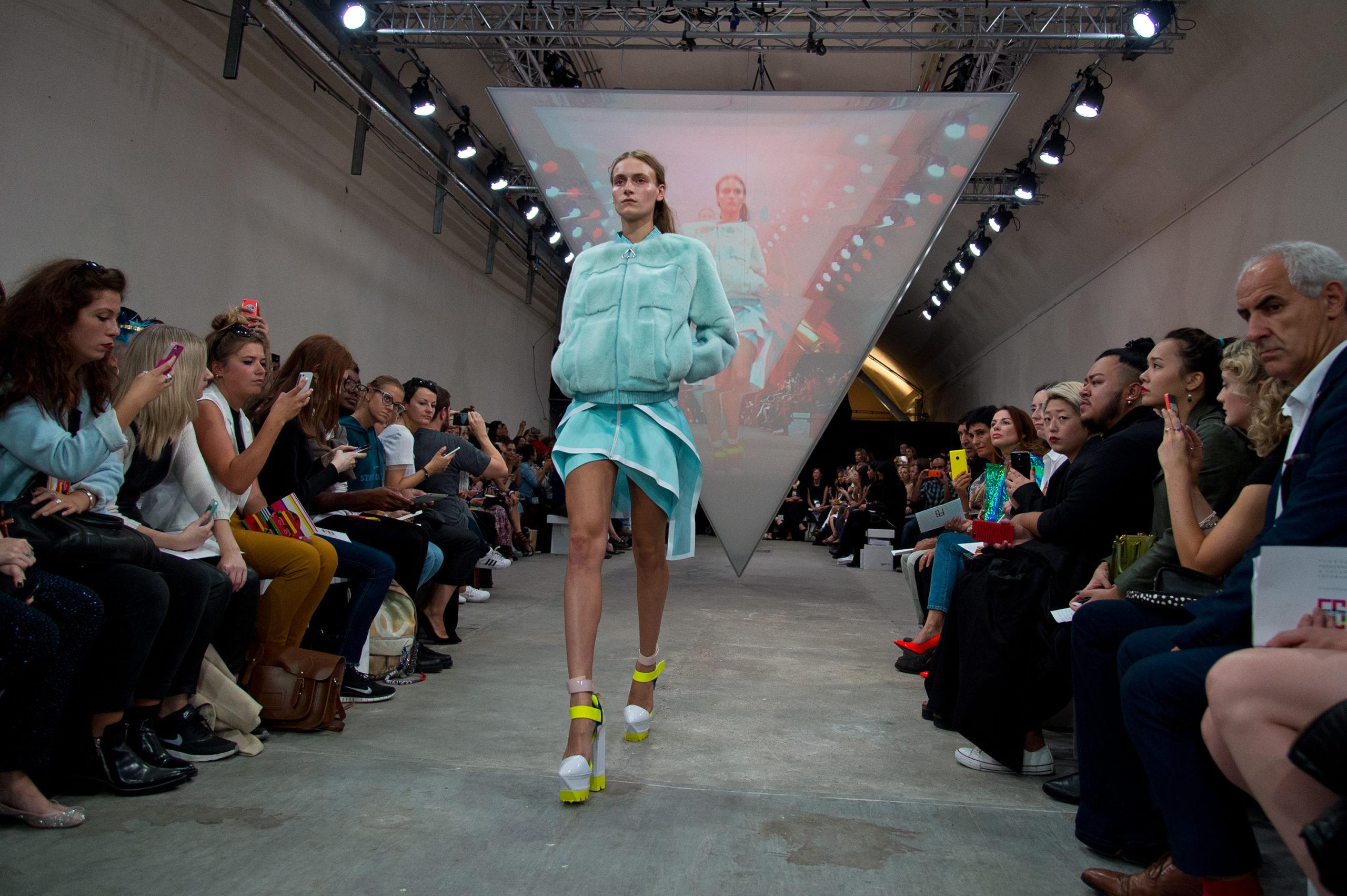 Model walking down catwalk for Fyodor Golan SS15 show, Fashion Innovation Agency