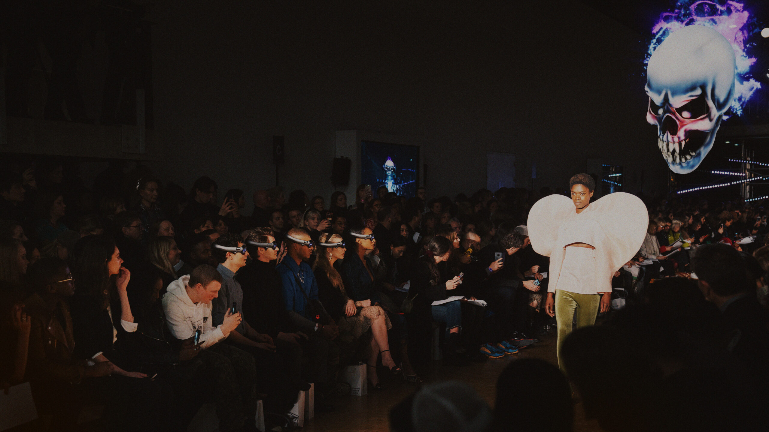 Catwalk show with audience wearing vr headsets