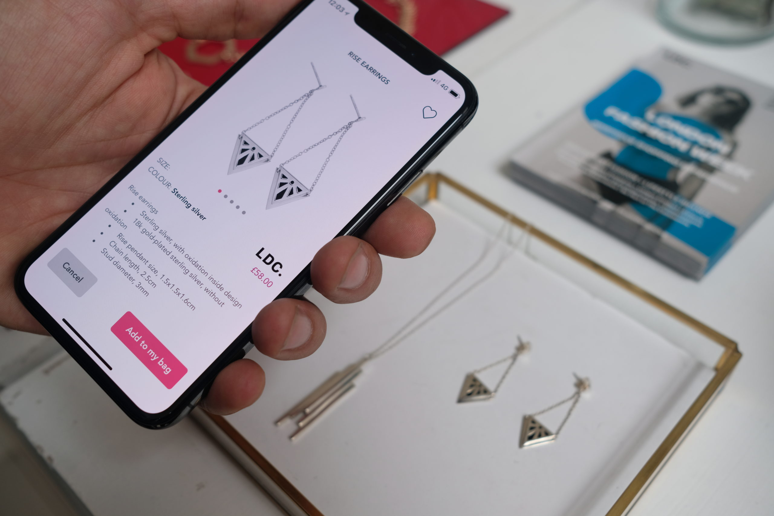 Mobile phone hovering over earnings to find more information