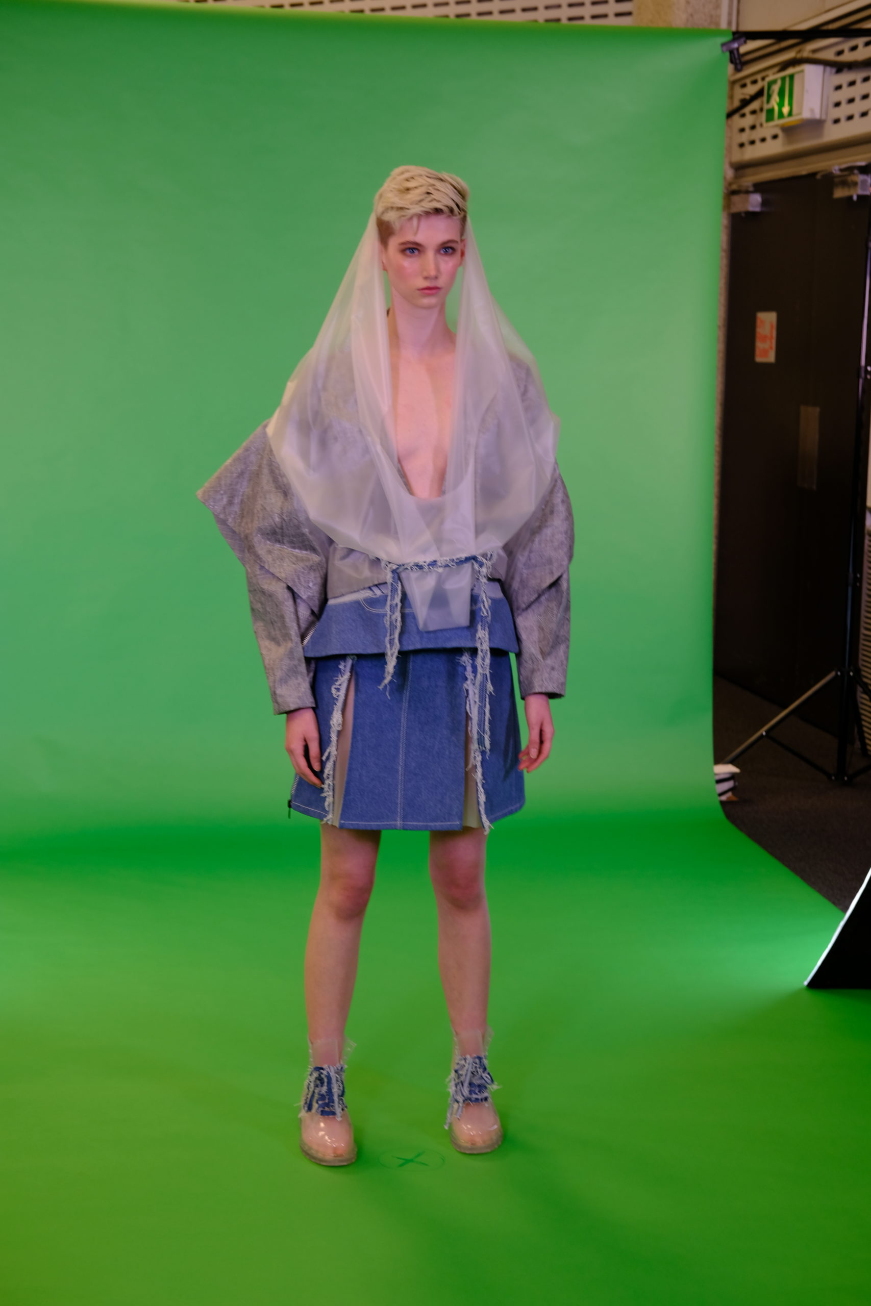 Model in from a green screen photo shoot set up, Fashion Innovation Agency