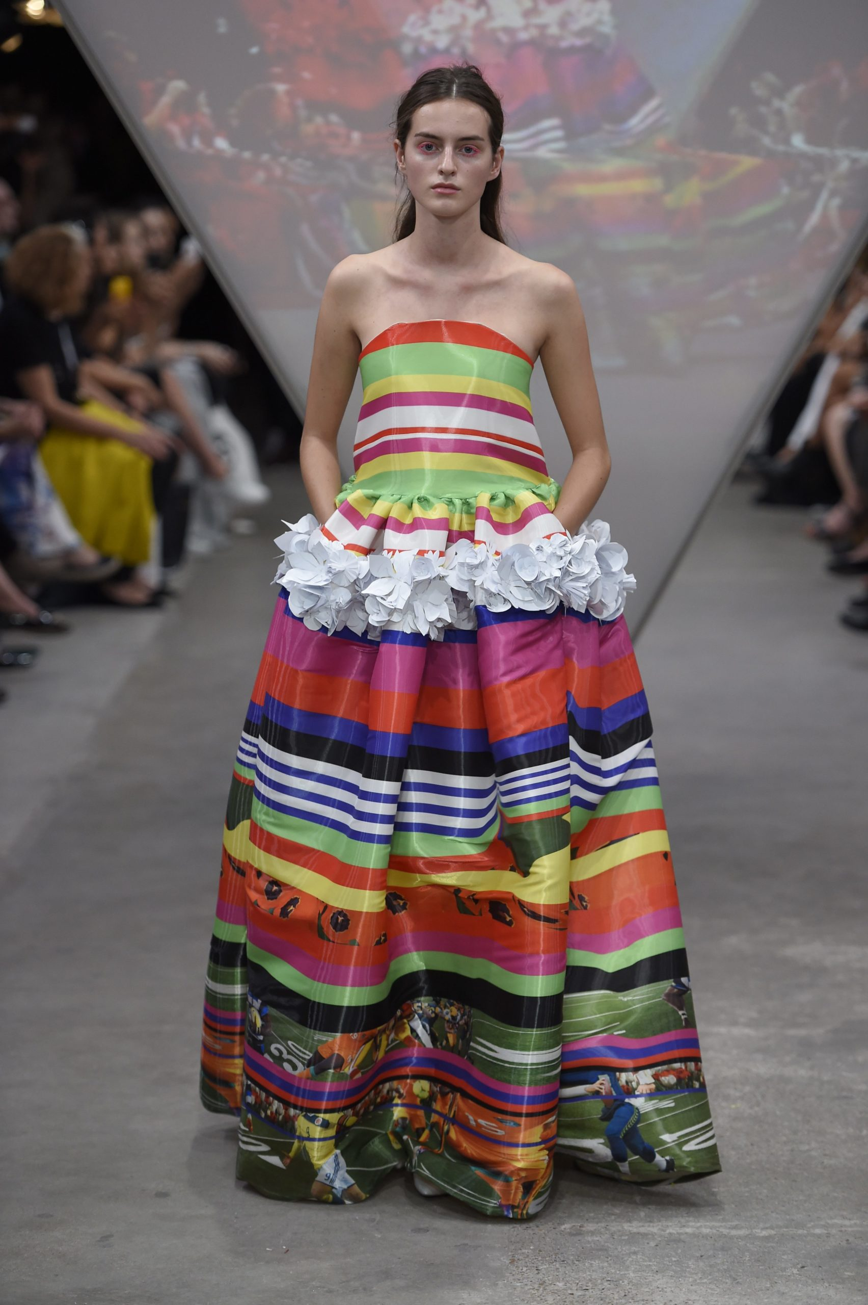Model walking down catwalk in multi-coloured dress for Fyodor Golan SS15 show, Fashion Innovation Agency