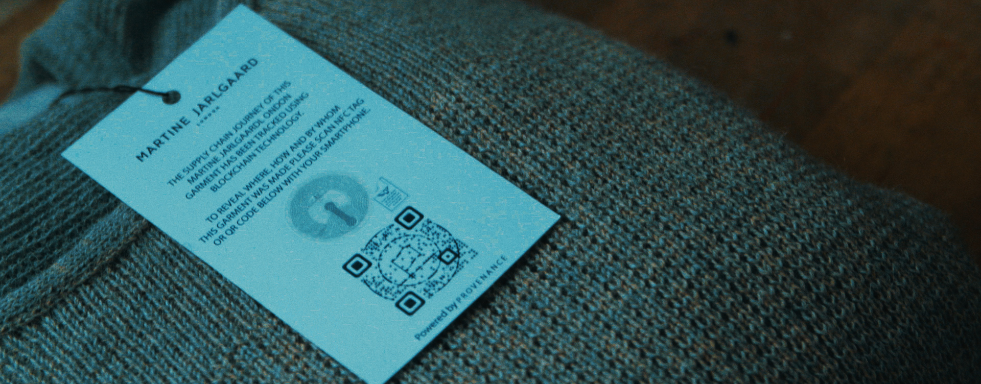 Clothing tag with QR code on Martine Jarlgaard London brand.