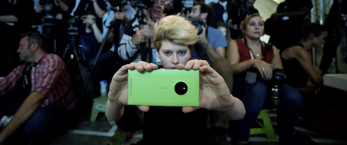 woman using a mobile phone at fashion show, Fashion Innovation Agency